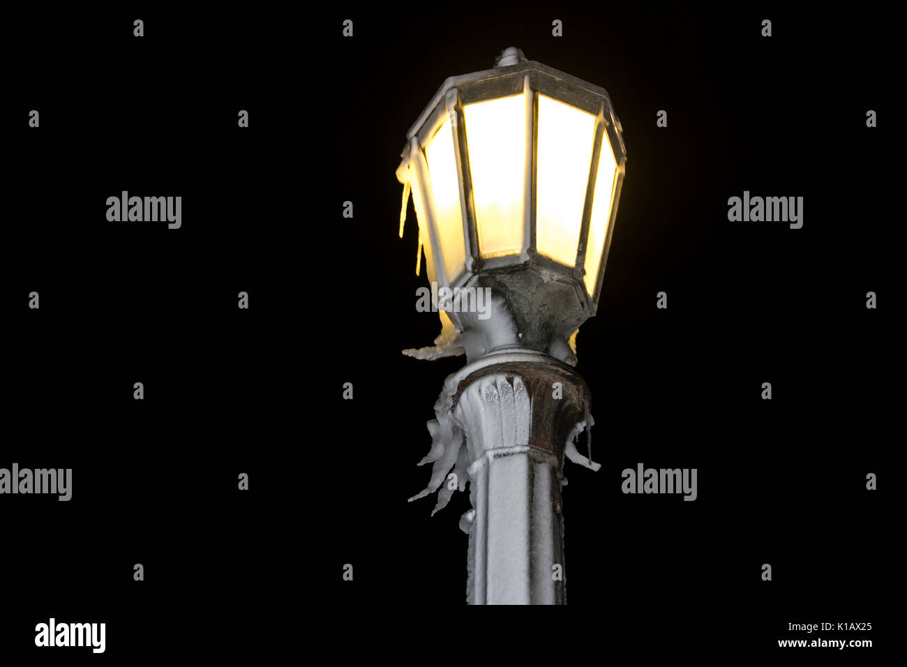 decorative street lamp covered by icicles, winter night Stock Photo