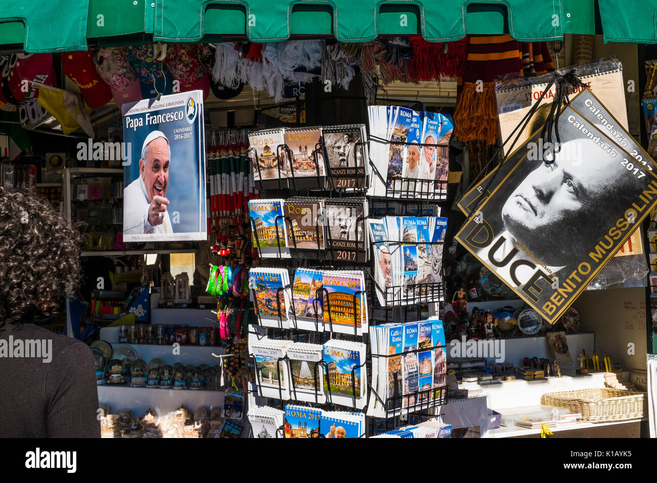 calendars for sale at a newsstand at piazza navonna, one of them displaying a portrait of pope francis, the other of benito mussolini, piazza navonna, - Stock Image