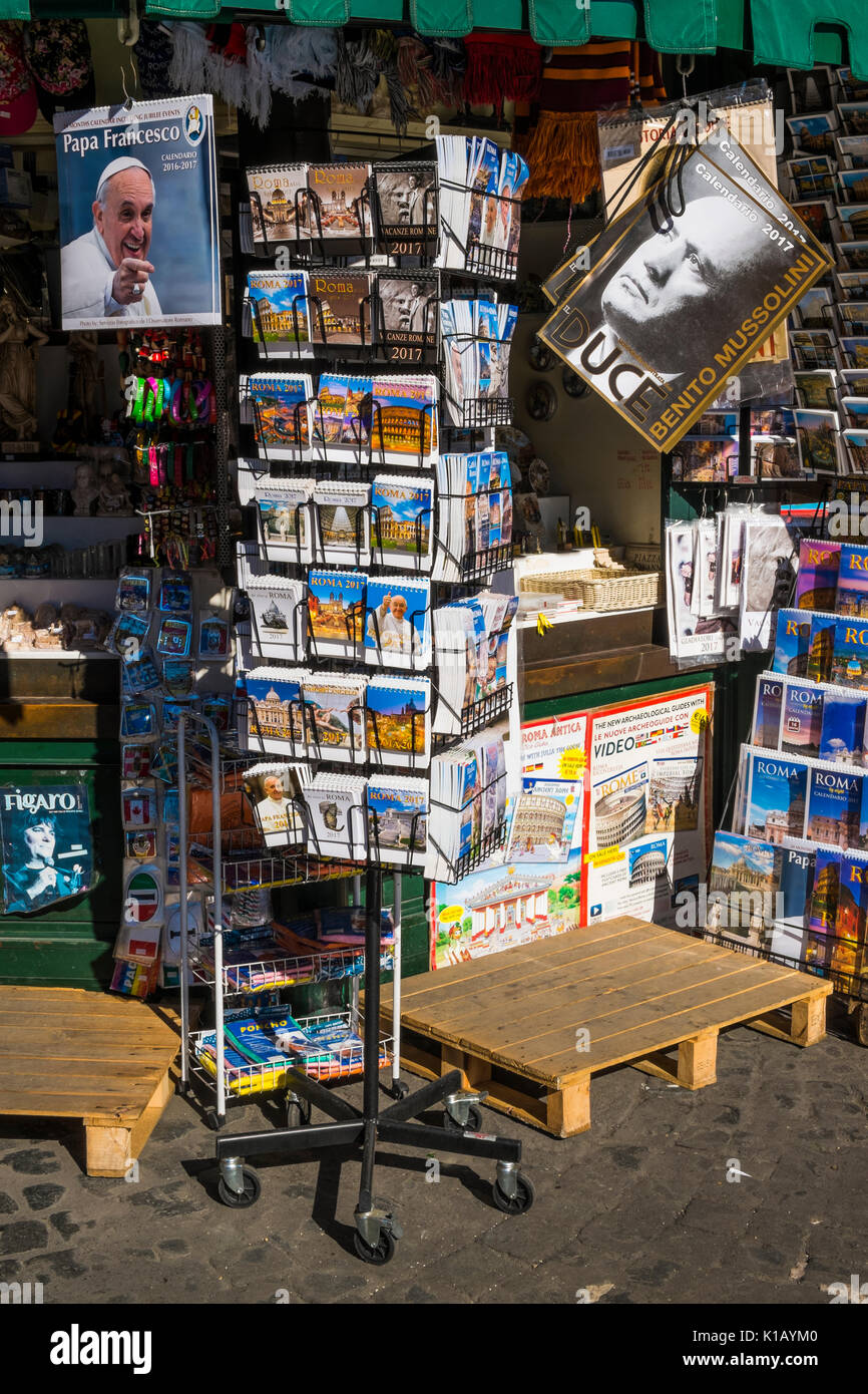 calendars for sale at a newsstand at piazza navonna, one of them displaying a portrait of pope francis, the other of benito mussolini - Stock Image