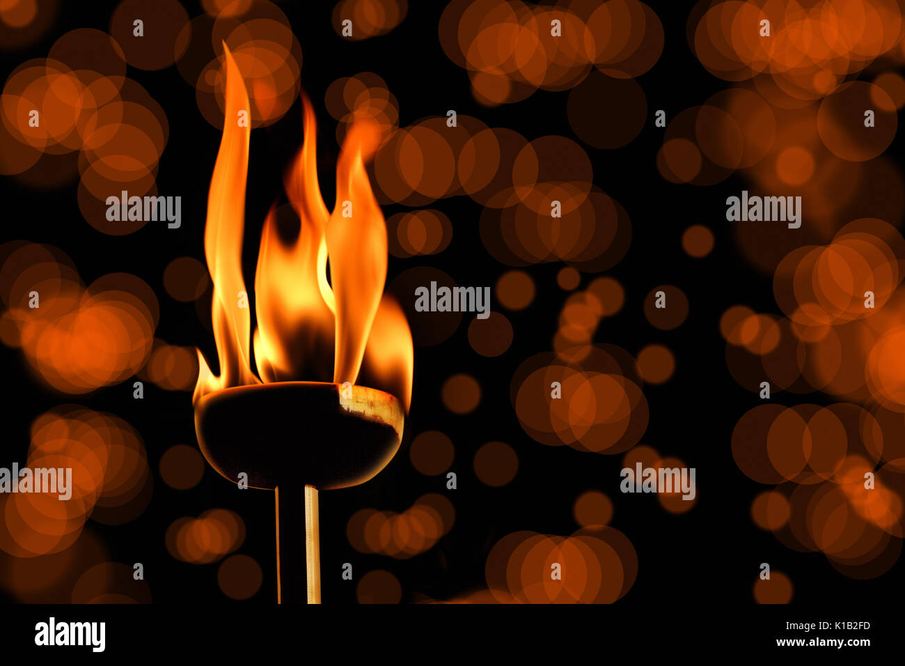 close up shot of burning flaming torch. Stock Photo
