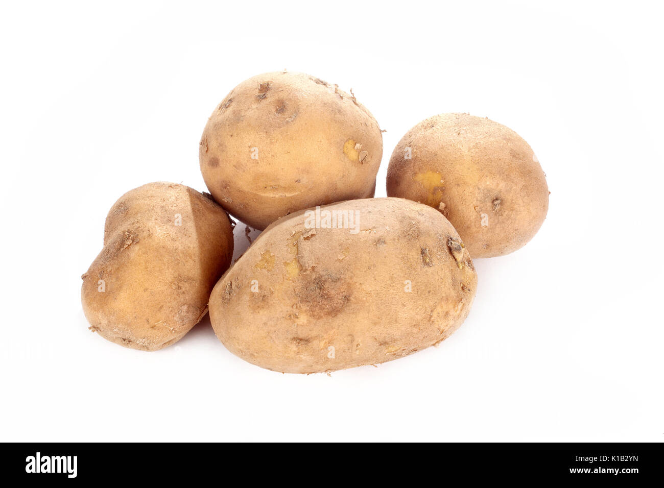close up shot of potatoes isolated on white background. - Stock Image