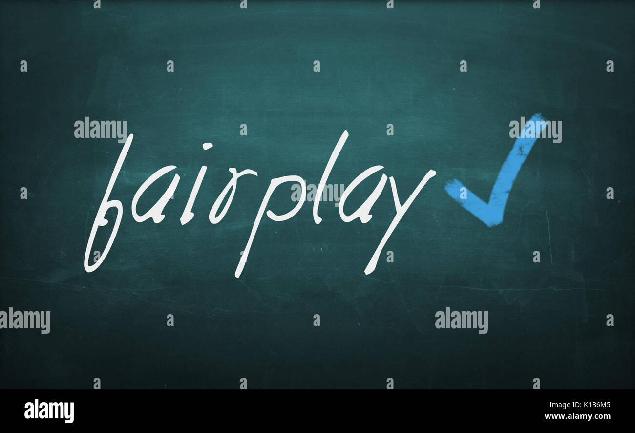 Conceptual text 'Fairplay' written with chalk on a dirty blackboard and checked with an OK sign. - Stock Image