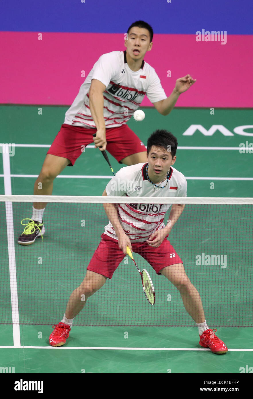 Indonesia's Marcus Fernaldi Gideon (front) and Kevin Sanjaya Sukamuljo in the quarter finals during day five of the 2017 BWF World Championships at the Emirates Arena, Glasgow. PRESS ASSOCIATION Photo. Picture date: Friday August 25, 2017. See PA story BADMINTON World. Photo credit should read: Jane Barlow/PA Wire. RESTRICTIONS: Editorial use only. No commercial use. - Stock Image