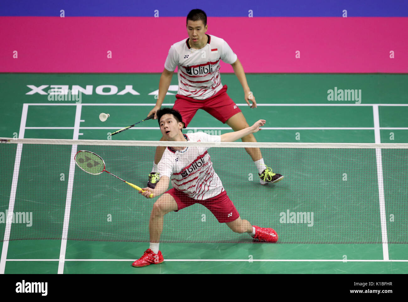 Indonesia's Marcus Fernaldi Gideon (front) and Kevin Sanjaya Sukamuljo in the quarter finals during day five of Stock Photo