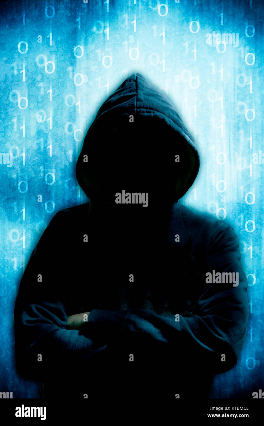 mysterious hacker in hood - Stock Image