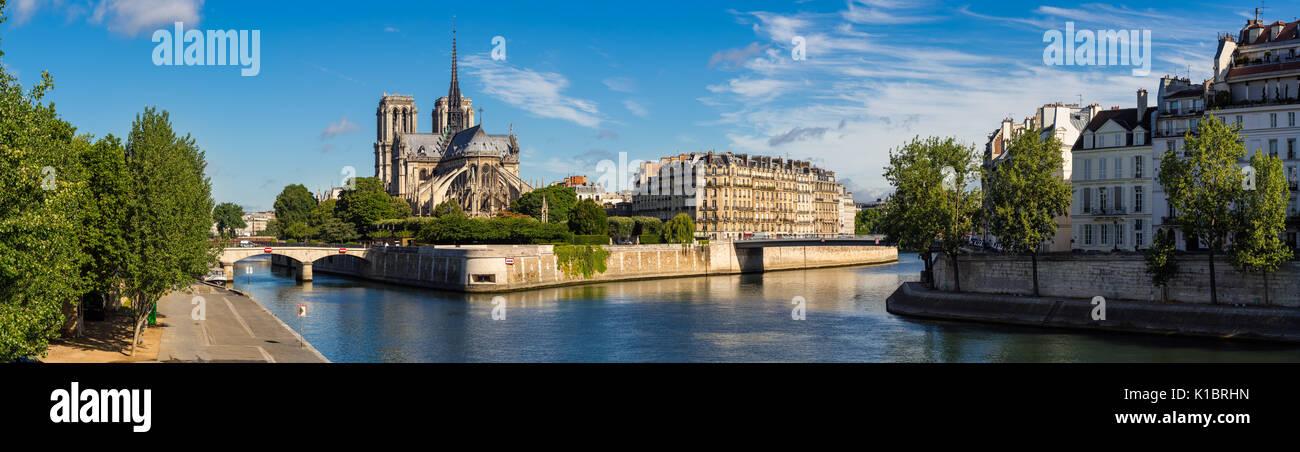 Morning panoramic view of Notre Dame de Paris cathedral and banks of the Seine River. Ile de la Cite, Ile Saint-Louis, Paris, France - Stock Image
