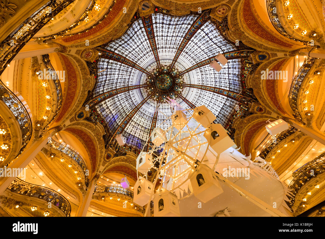 Galleries Lafayette Haussman interior with glass cupola at Christmas. Paris, France - Stock Image