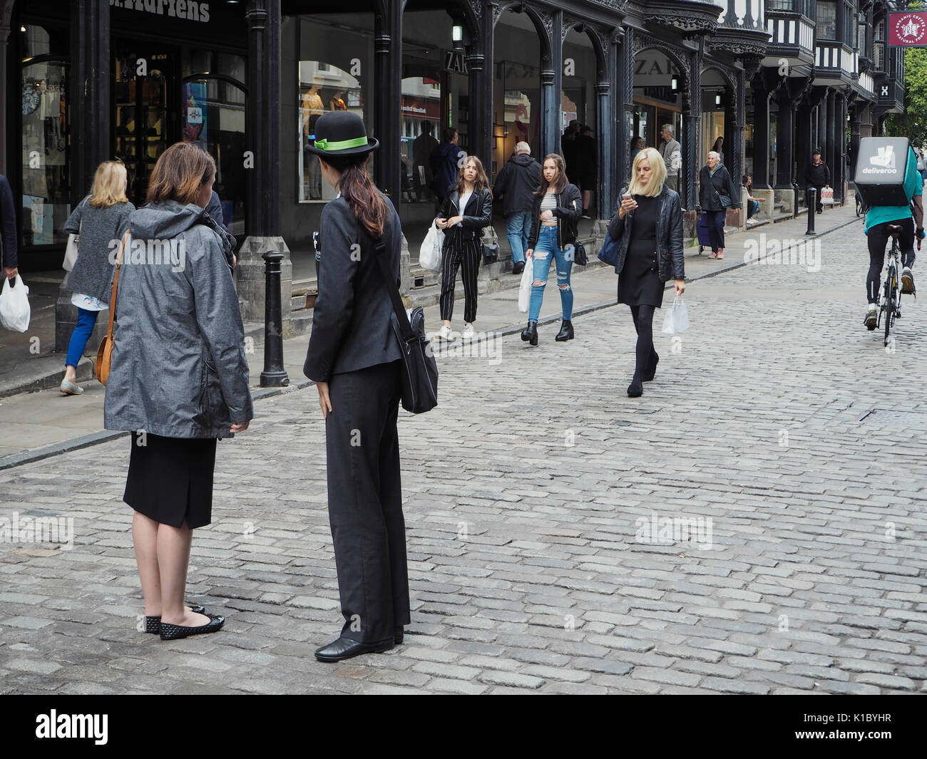 Tourist information person in Chester - Stock Image