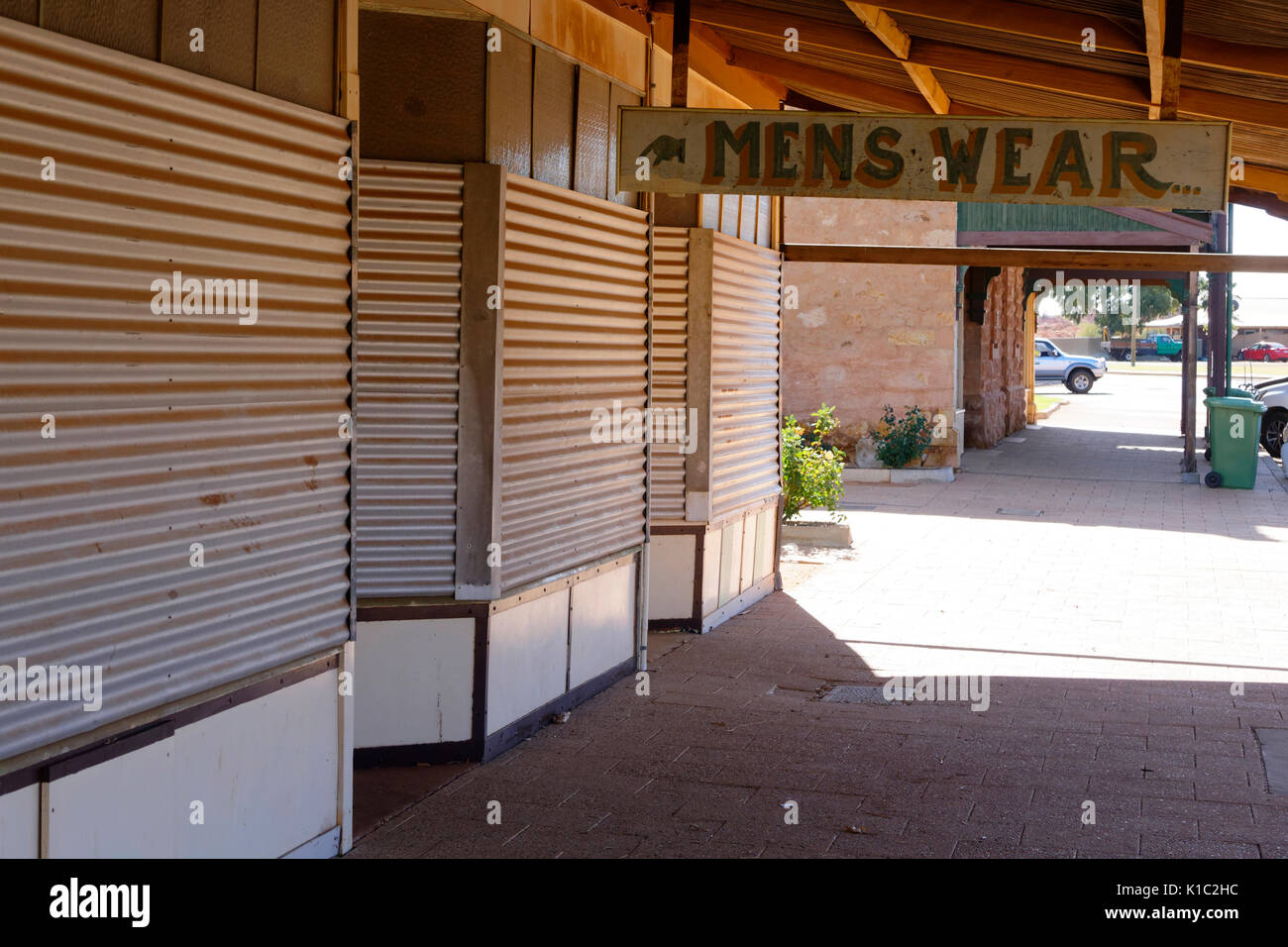 Closed shop windows covered with tin sheeting, Cue, Murchison, Western Australia - Stock Image