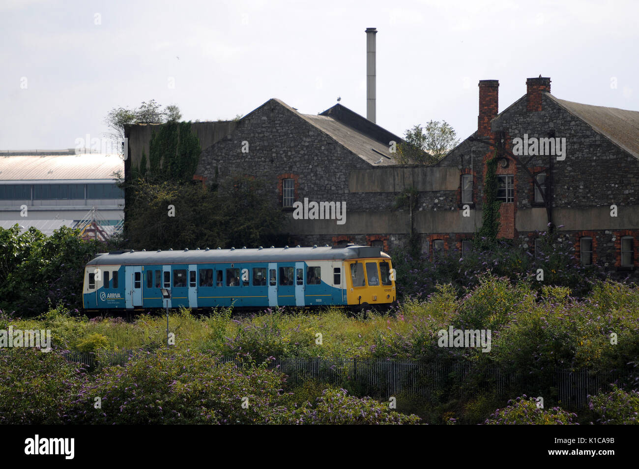 Single car 121 032 with a Cardiff Bay (Formerly Cardiff Bute Road) to Cardiff Queen Street service. - Stock Image
