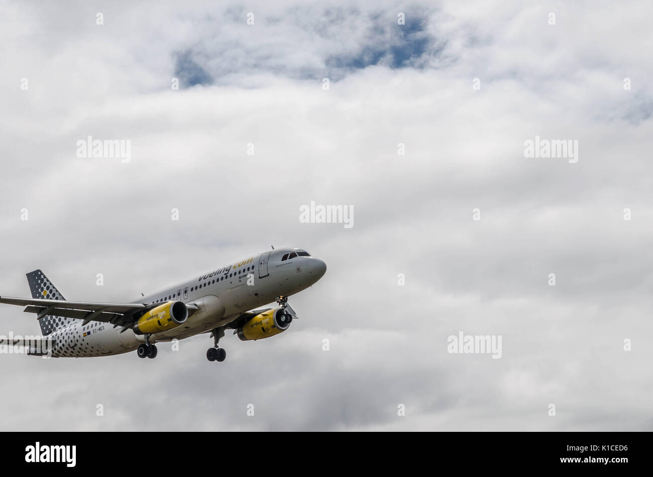 A Vueling Airbus A320 landing at Cardiff Airport, Wales, UK. - Stock Image