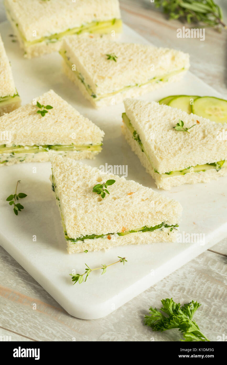 Homemade Cucumber Tea Sandwiches with Herb Butter - Stock Image
