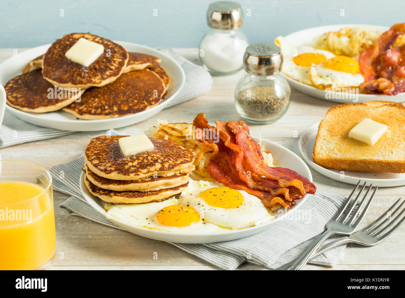 Healthy Full American Breakfast with Eggs Bacon and Pancakes Stock Photo