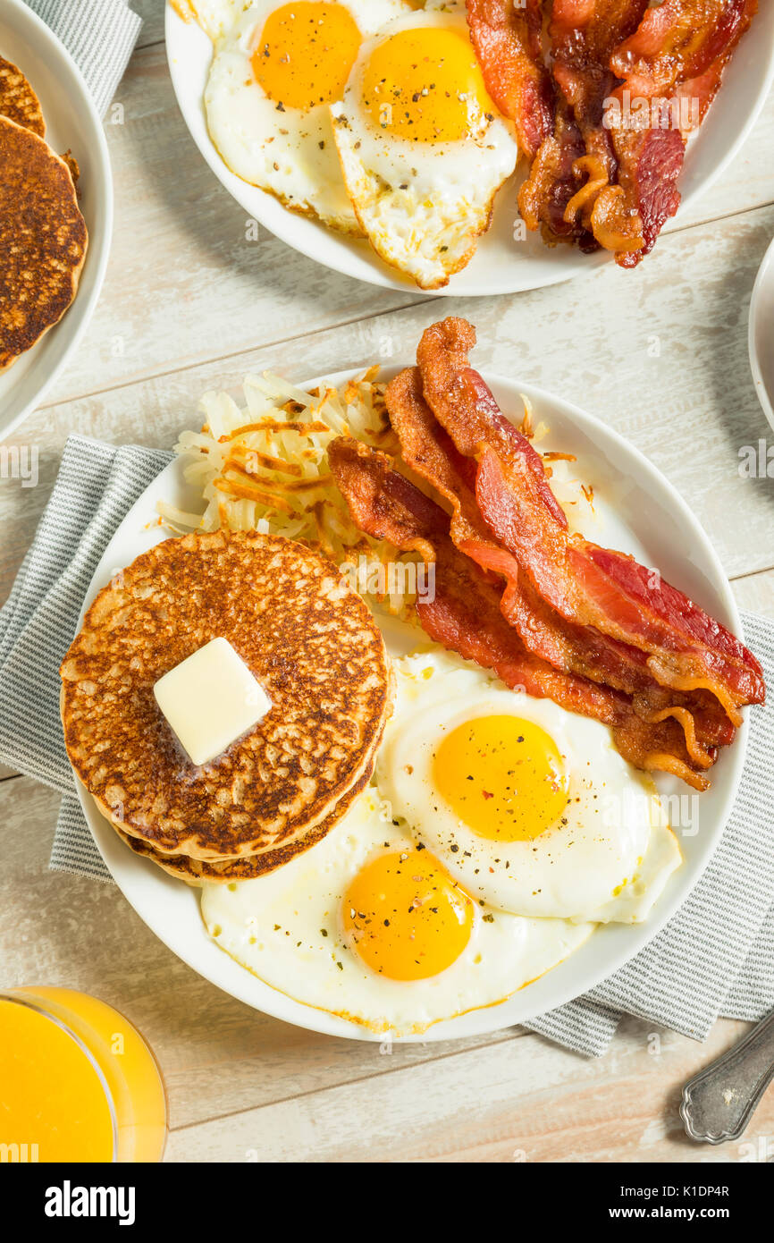 Healthy Full American Breakfast With Eggs Bacon And Pancakes Stock