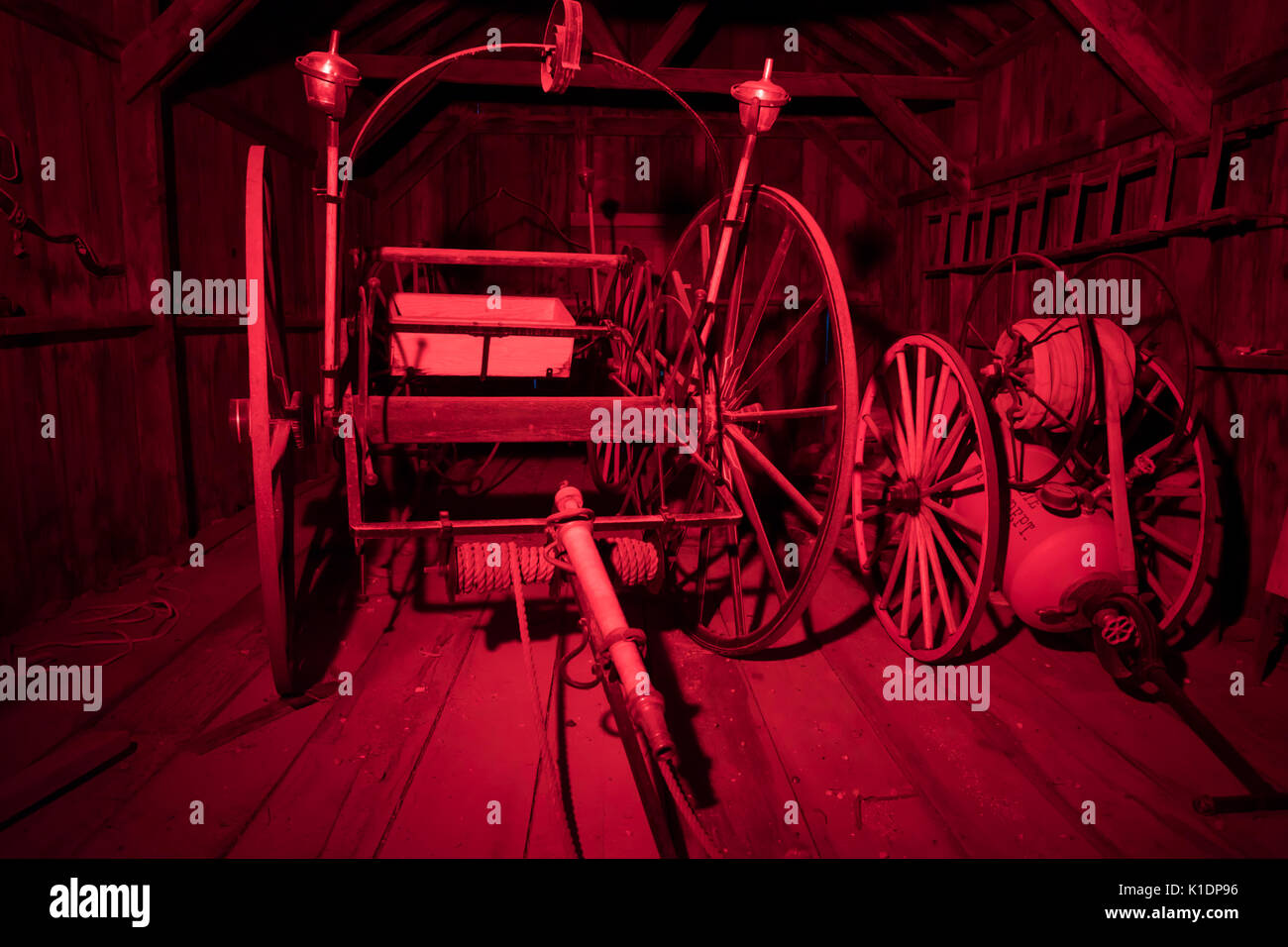 Firefighting equipment inside firehouse in Bodie State Historic Park. - Stock Image