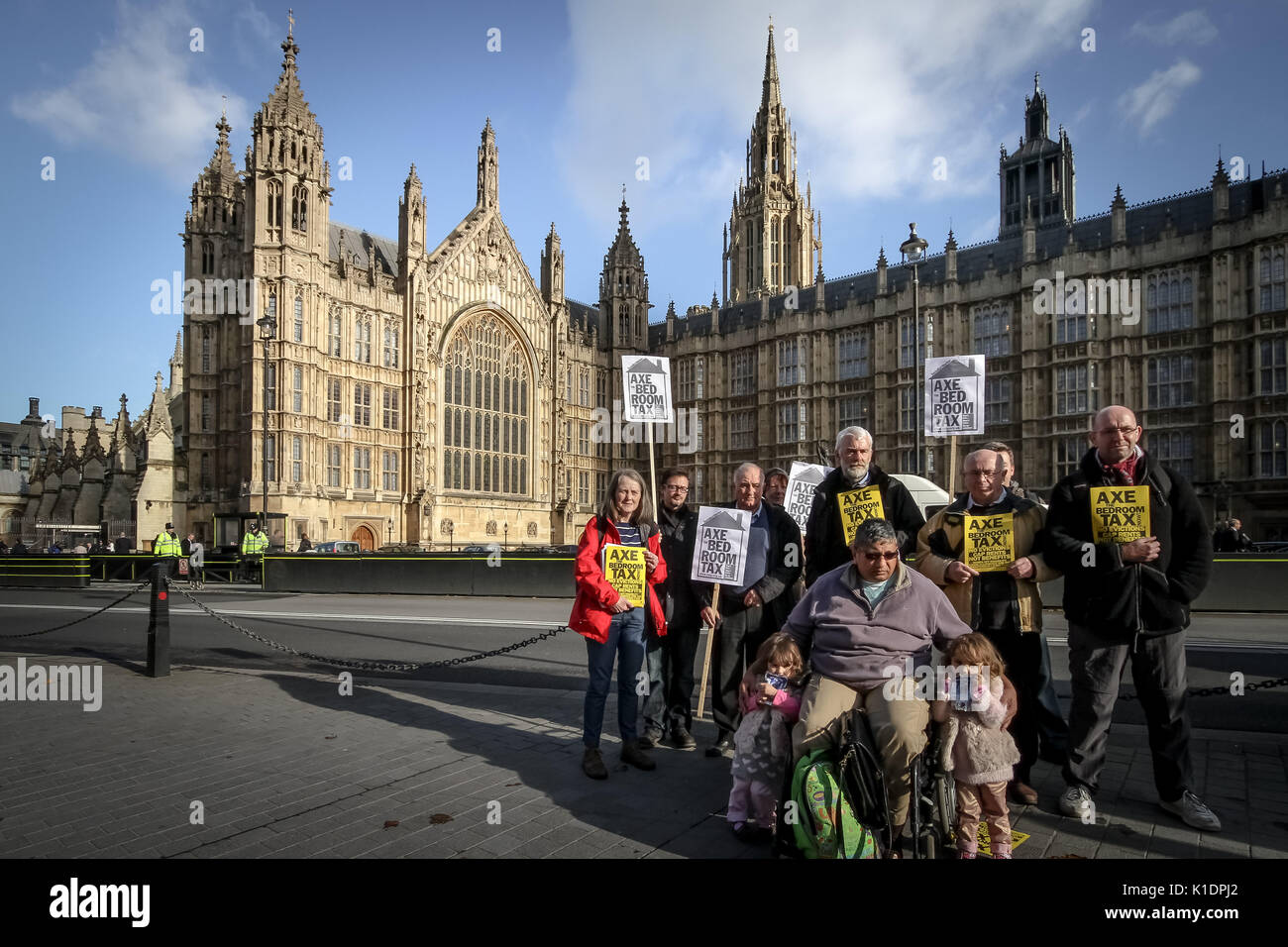 'Axe Bedroom Tax'. Anti-bedroom tax protesters demonstrate in Old Palace Yard opposite Westminster's Parliament Stock Photo