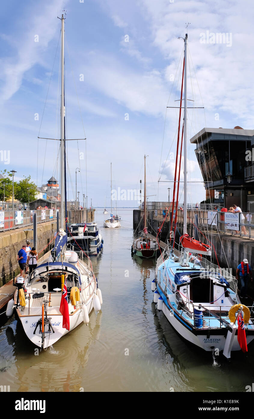 Bristol, UK. 26th August, 2017. Saturday 26th August 2017. Bank holiday weekend. Sailing boats leave Portishead Marina, Somerset, via the lock gates and head out into the Bristol Channel at the start of the Bank Holiday Weekend. All hoping to make the most of the good weather forecast for the UK over the holiday weekend. Credit: Stephen Hyde/Alamy Live News - Stock Image