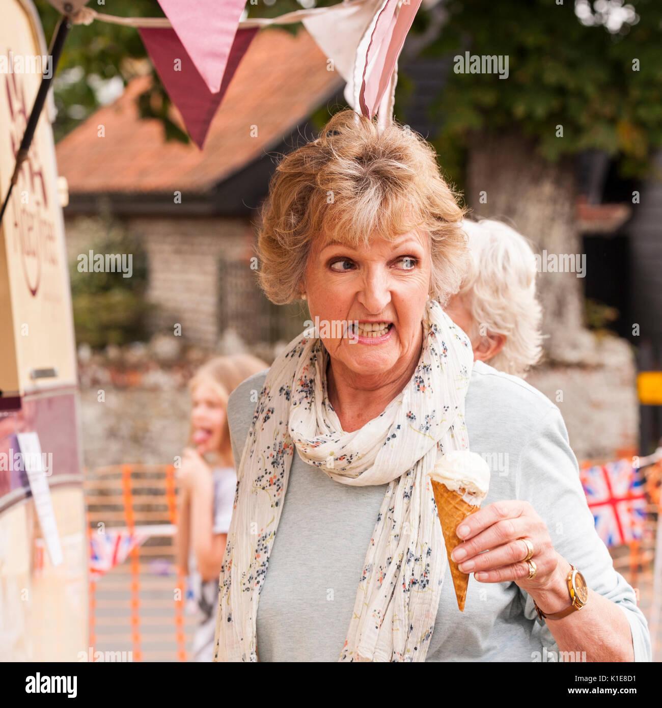 Walberswick, Suffolk, England, Uk. 26th August 2017. Penelope Keith eating an ice cream at Walberswick village fete. Tim Oram/Alamy Live News - Stock Image
