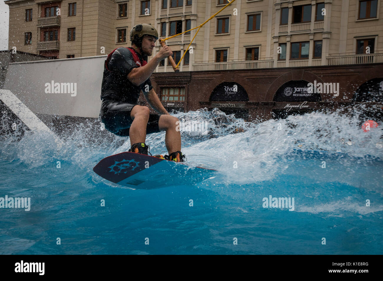 Moscow, Russia. 25th of August, 2017. A wakeboard rider jumps during openin the wake park near the Red square in the center of Moscow, Russia Credit: Nikolay Vinokurov/Alamy Live News - Stock Image