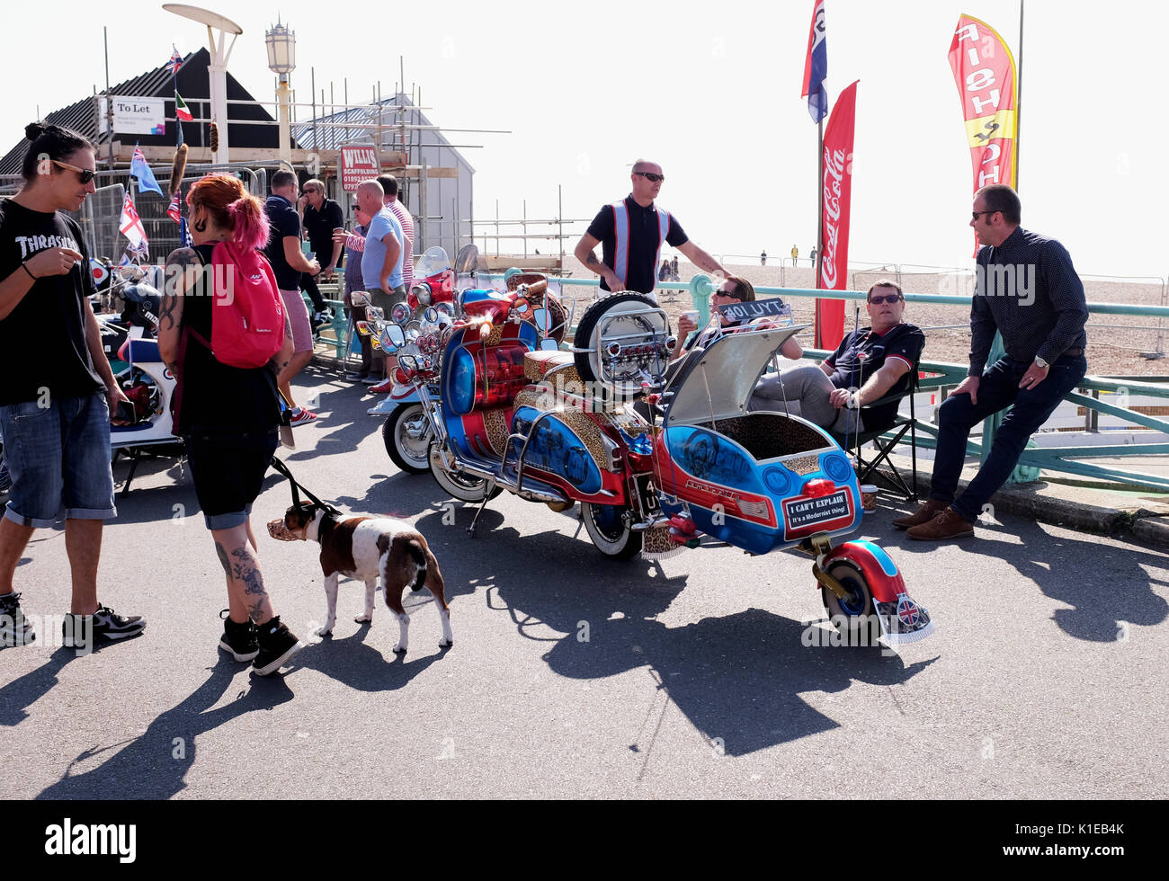 Brighton, UK. 27th Aug, 2017. Hundreds of Mods invade Brighton seafront as they take part in the Brighton Mod Weekender event over the bank holiday weekend in beautiful hot sunny weather . Mods have traditionally visited Brighton for the August Bank Holiday since the 1960s when there quite often used to be trouble on the seafront with battles between themselves and rockers Credit: Simon Dack/Alamy Live News - Stock Image