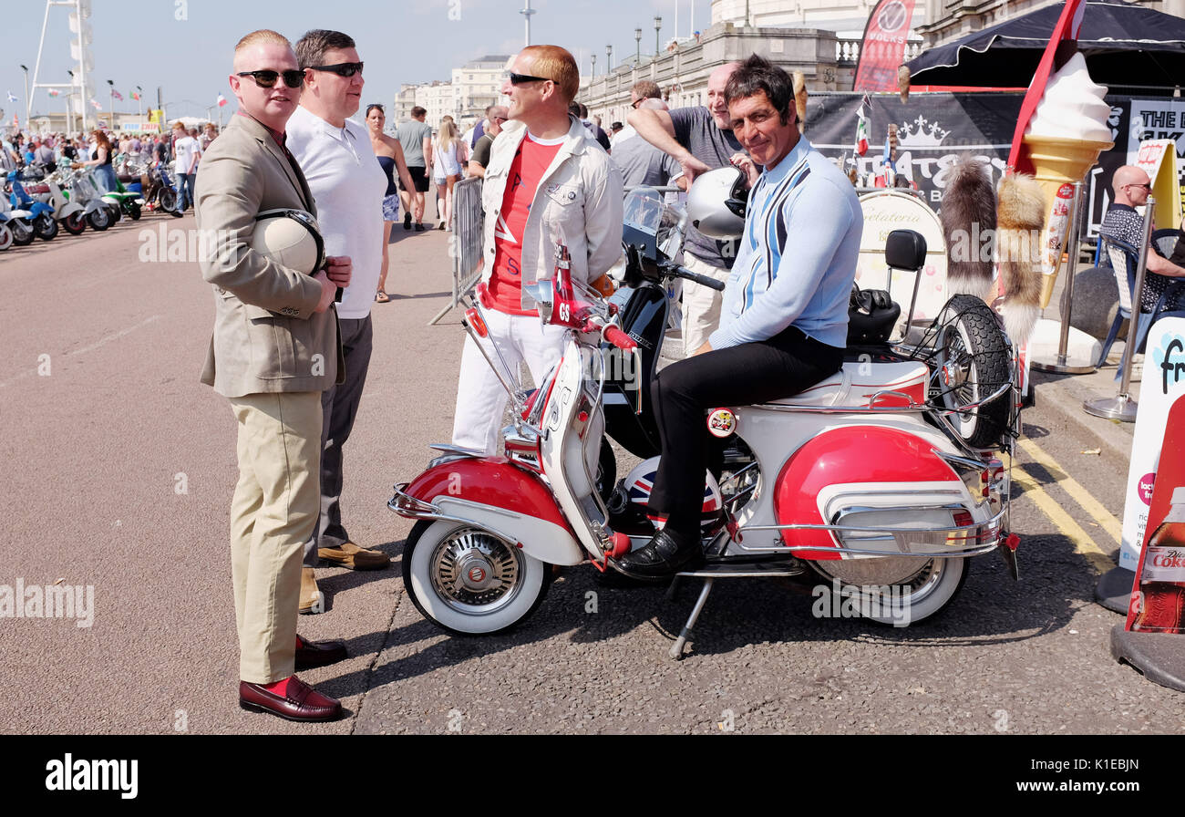 Brighton, UK. 27th Aug, 2017. Hundreds of Mods take part in the Brighton Mod Weekender event over the bank holiday weekend in beautiful hot sunny weather . Mods have tarditionally visited Brighton for the August Bank Holiday since the 1960s when there quite often used to be trouble on the seafront with battles between themselves and rockers Credit: Simon Dack/Alamy Live News - Stock Image