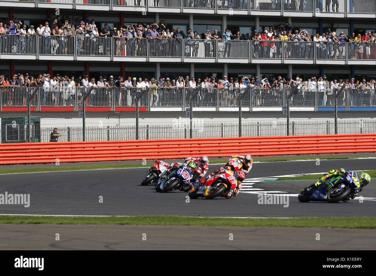 Silverstone, UK. 27th Aug, 2017.  1st lap of the OCTO British MotoGP in front of a large crowd Rossi leads from Marquez, Vinales, Crutchlow and winner Dozizisio Credit: Motofoto/Alamy Live News - Stock Image