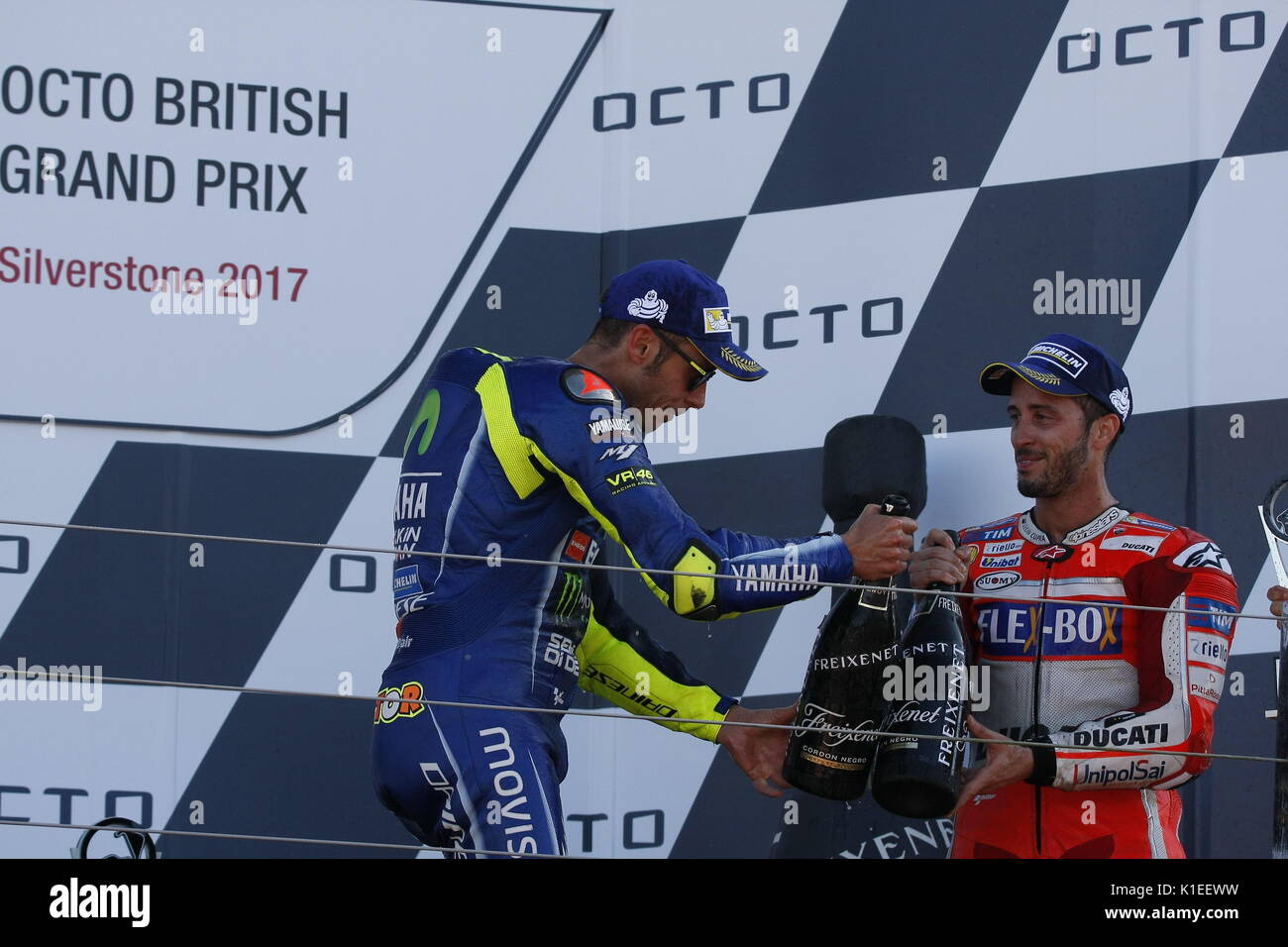 Silverstone, UK. 27th Aug, 2017.  Cheers! Rossi and Dovizioso toast each other's success after the OCTO British MotoGP Credit: Motofoto/Alamy Live News - Stock Image