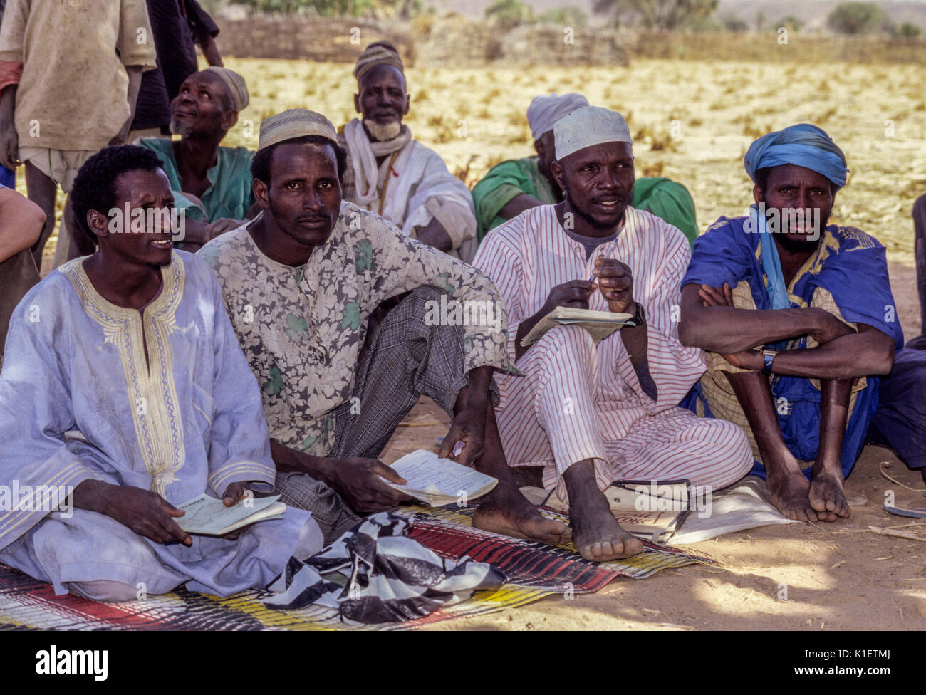 Niger, Doutouel Village, West Africa.   Men Attending  Adult Literacy Class. Stock Photo