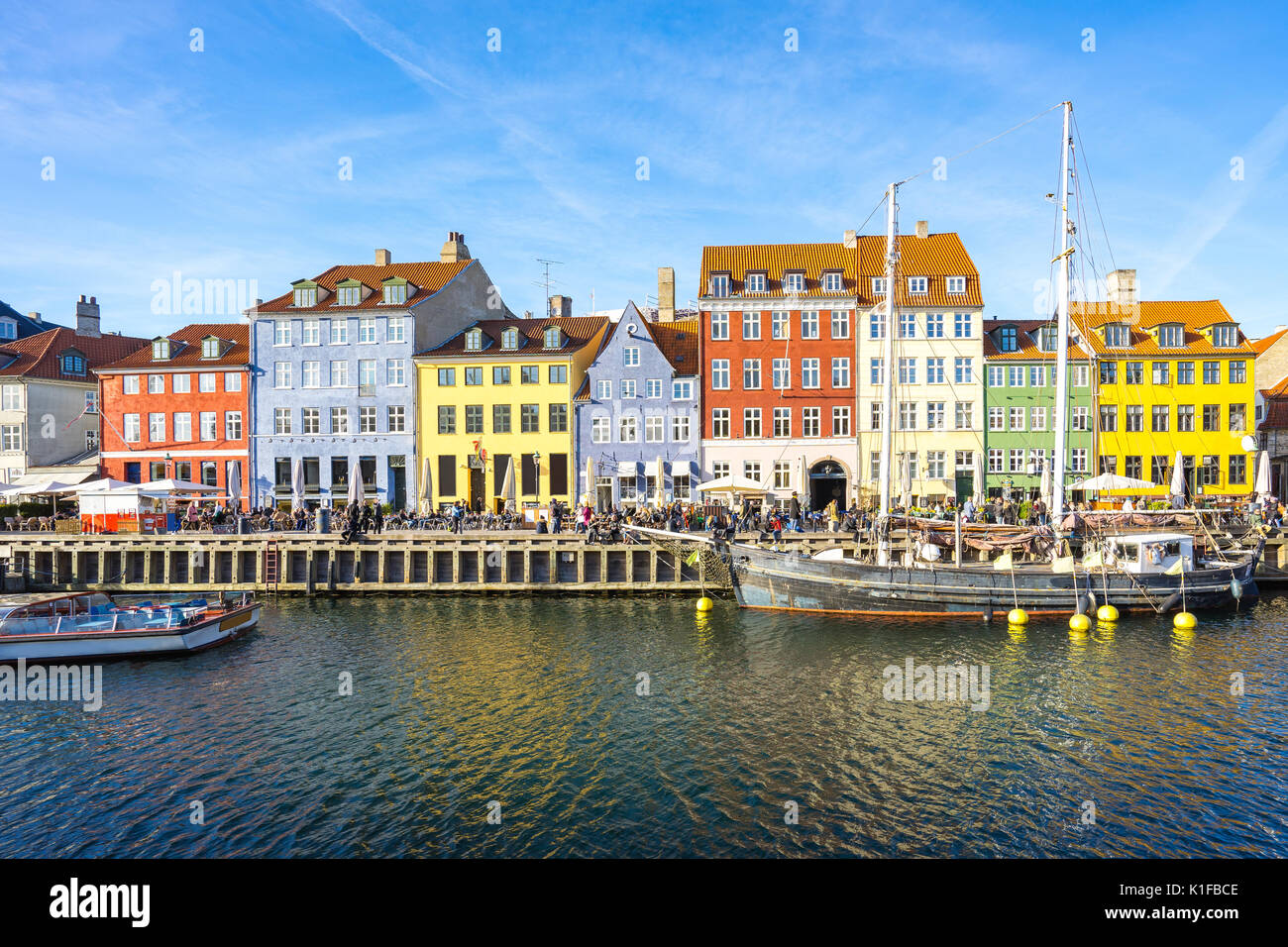Copenhagen, Denmark - May 1, 2017: Nyhavn was originally a busy commercial port where ships from all over the world would dock. The area was packed wi - Stock Image