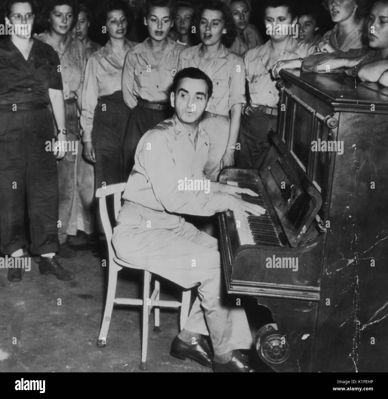 Irving Berlin plays for the United States Army Womens Army Corps at their mess hall, Hollandia, Dutch New Guinea, December 24, 1944. From the New York Public Library. - Stock Image