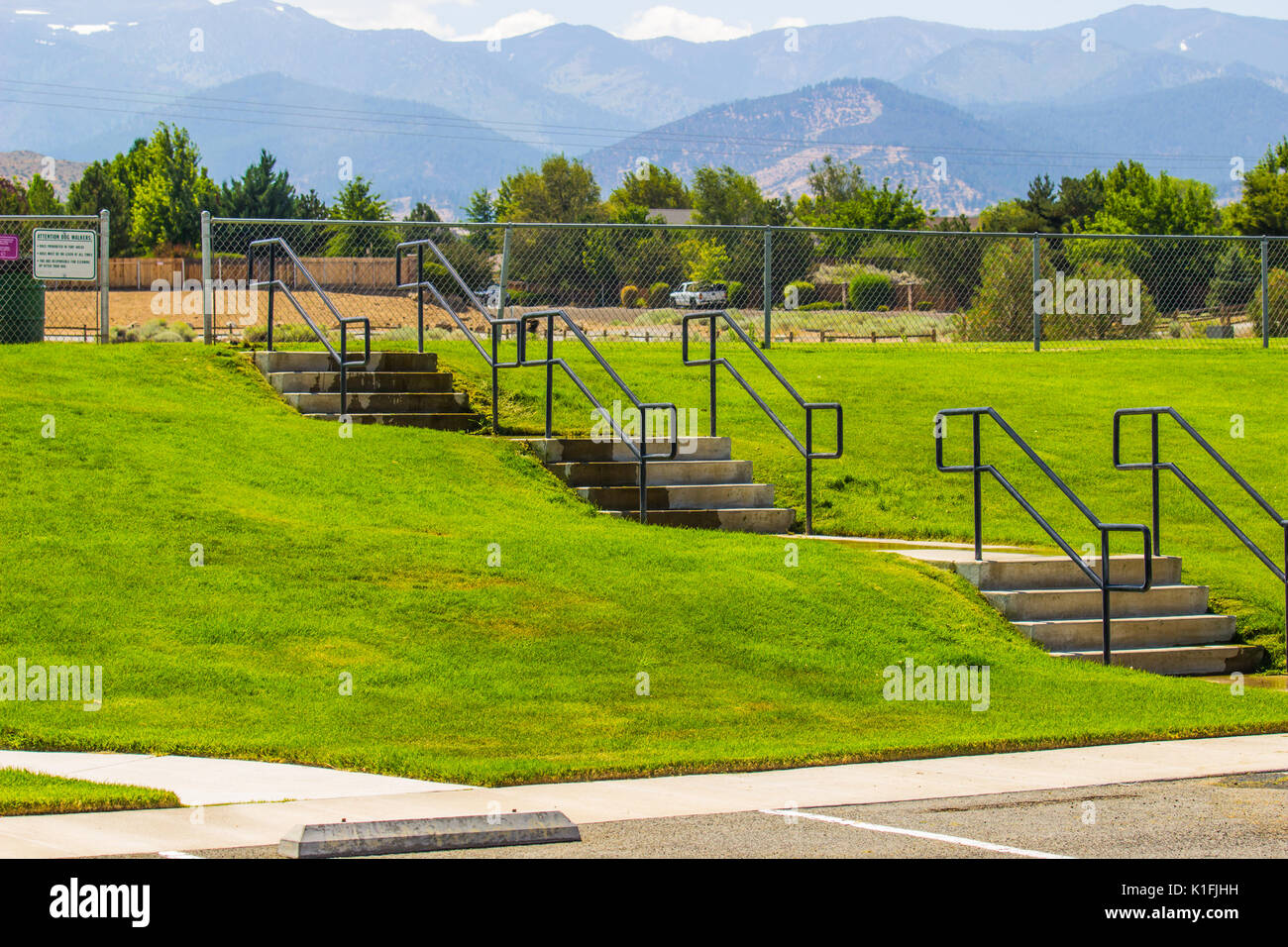 Steps With Handrails Leading To Playing Field - Stock Image