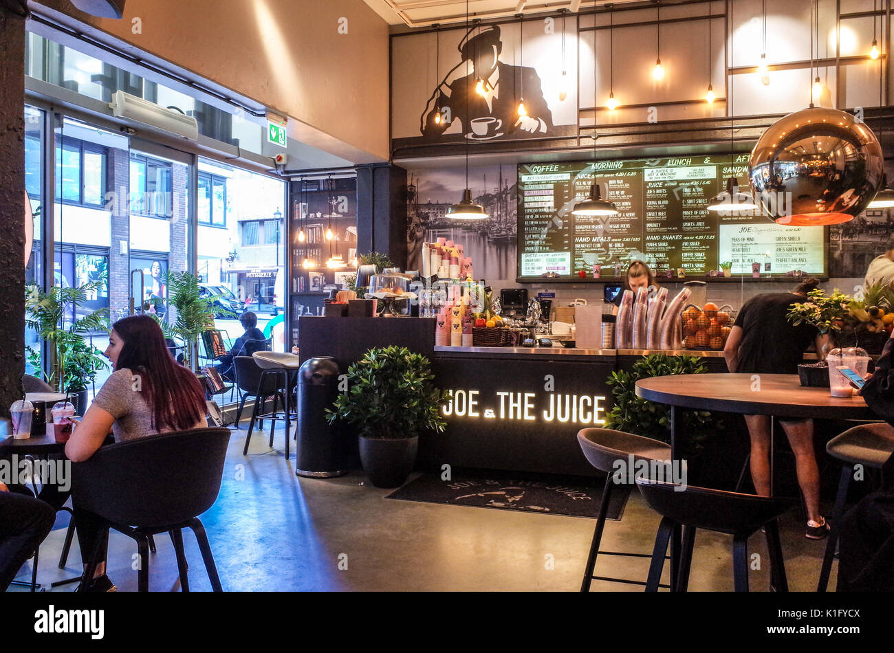 Joe & the Juice cafe in Soho central London - interior view of a London branch of this Danish Coffee and Juice cafe chain - Stock Image