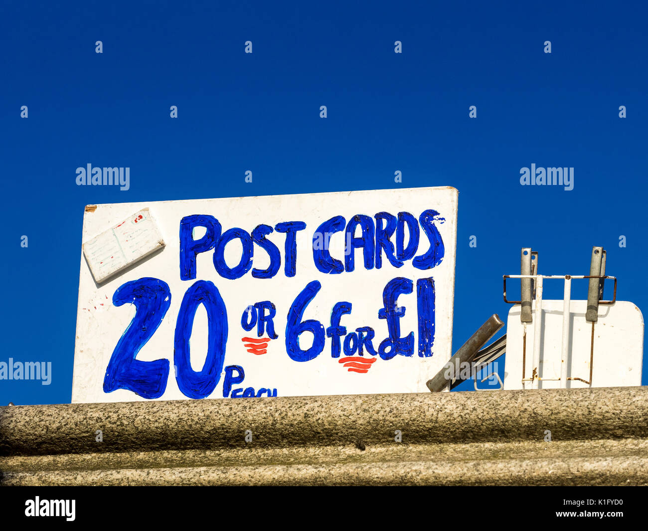 Postcards for Sale sign on London's Southbank riverside walk - Stock Image