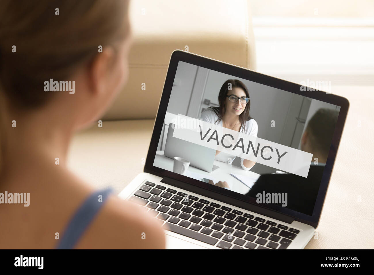 Young unemployed woman looking for job, online work search, clos - Stock Image