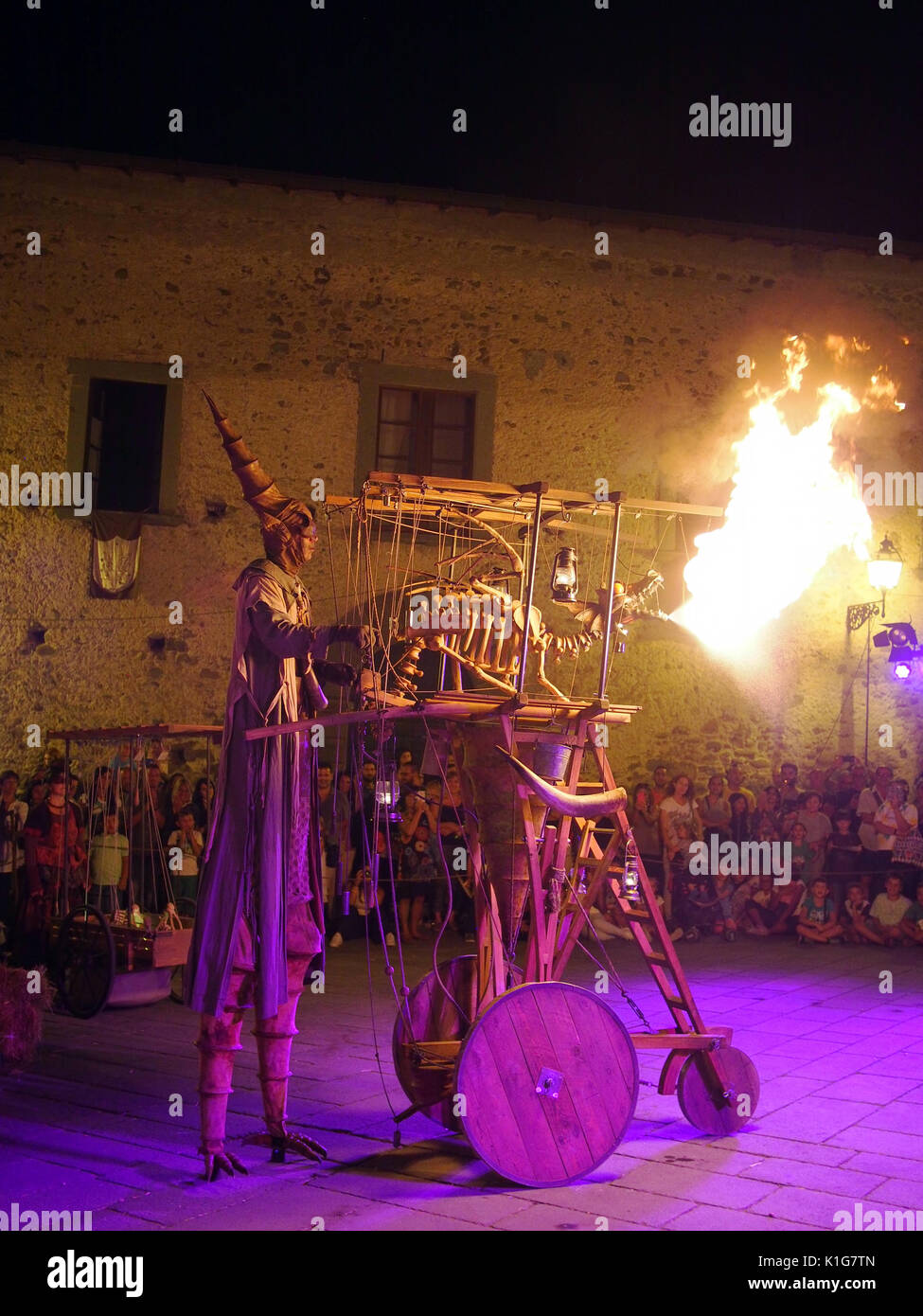 FILETTO, ITALY - AUGUST 15,2017: The annual Medieval market. Here Ottfried and his fire breathing dragon entertain the crowds. - Stock Image