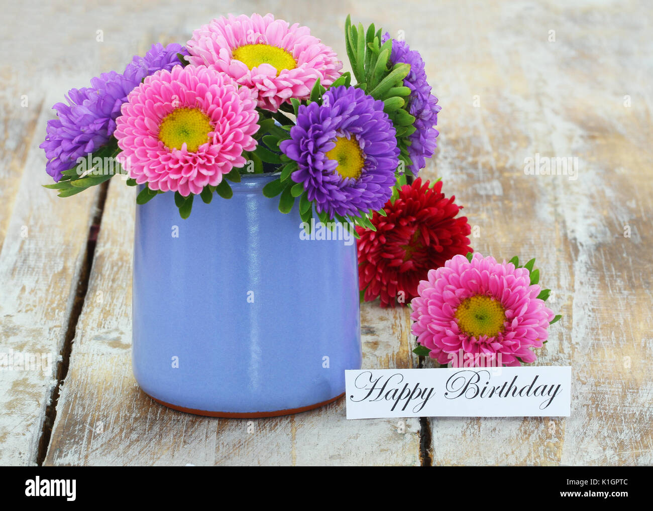 Happy birthday card with colorful daisy flowers in blue pot on happy birthday card with colorful daisy flowers in blue pot on rustic wooden surface izmirmasajfo