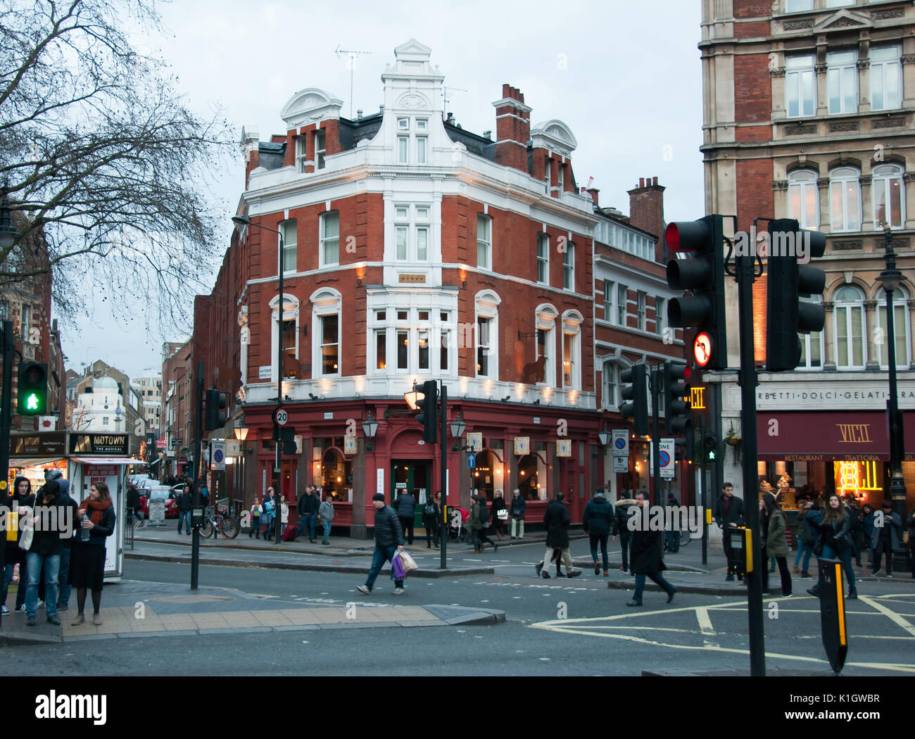London, England. 06 march, 2016. Shaftesbury Avenue in the late afternoon. Pedestrins and traffic light. - Stock Image