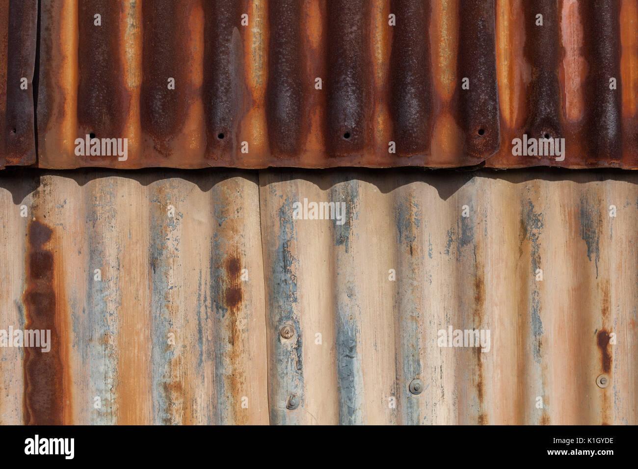 Rusty galvanized iron sheets background pattern - Stock Image