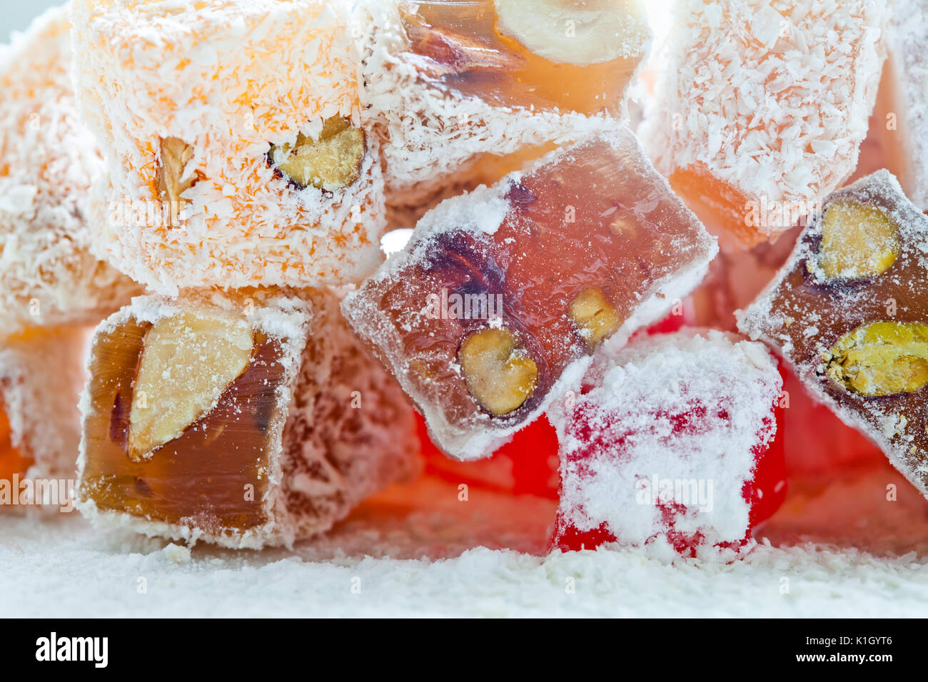 Tasty oriental sweets (Turkish delight lokum) with powdered sugar. - Stock Image