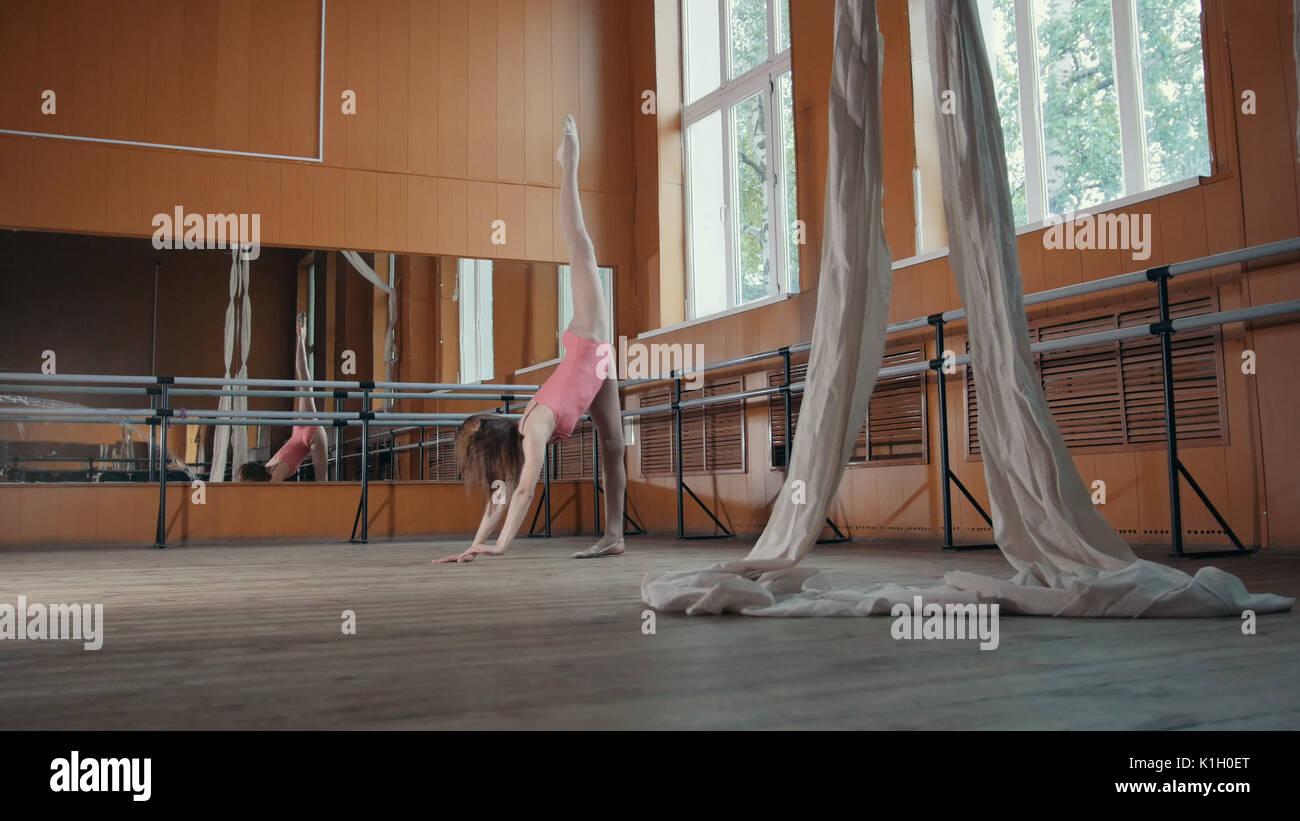 Graceful girl ballerina practicing in the Studio, elements of dance - Stock Image