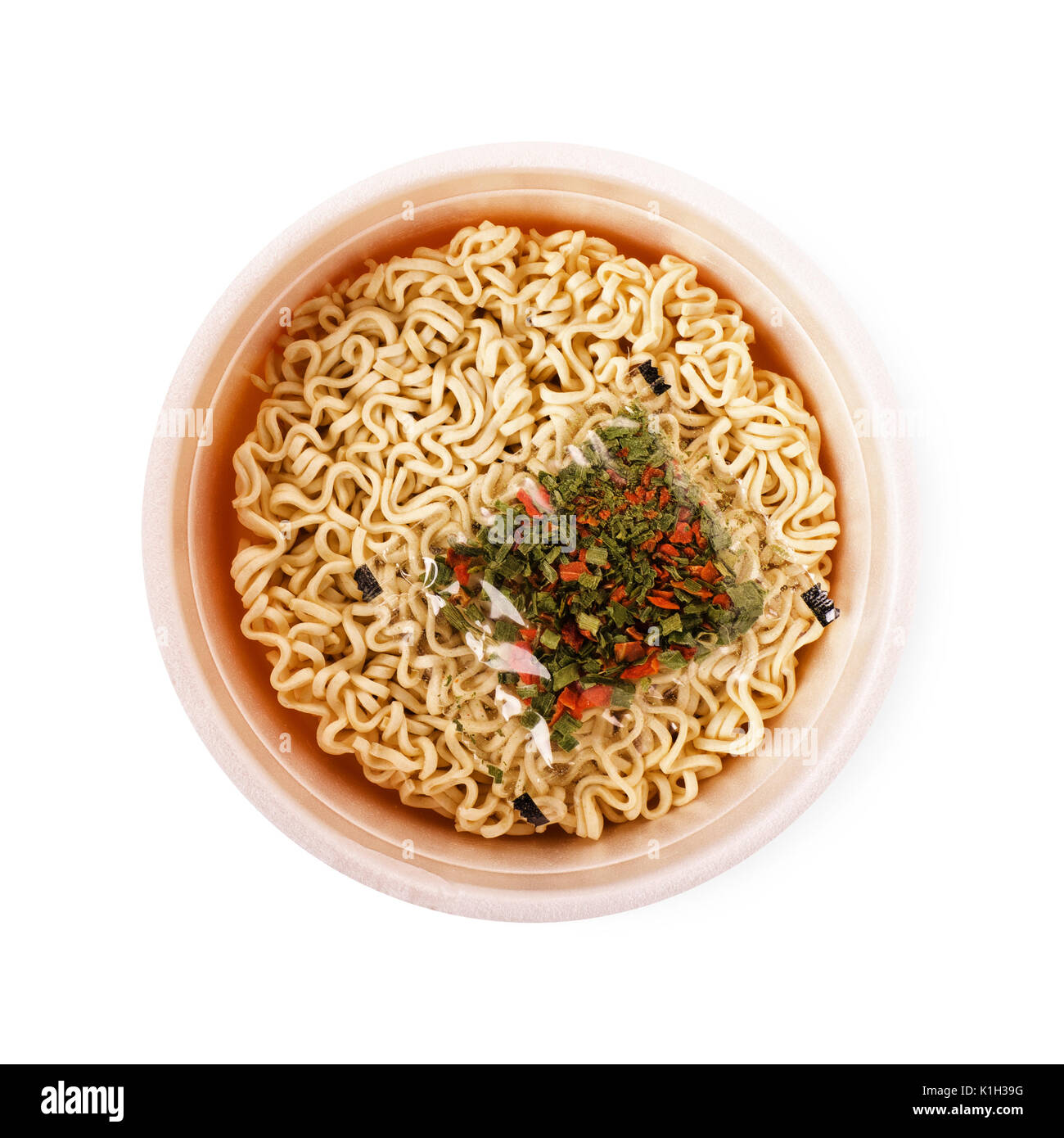 Bowl of instant noodles with spice isolated on white background - Stock Image
