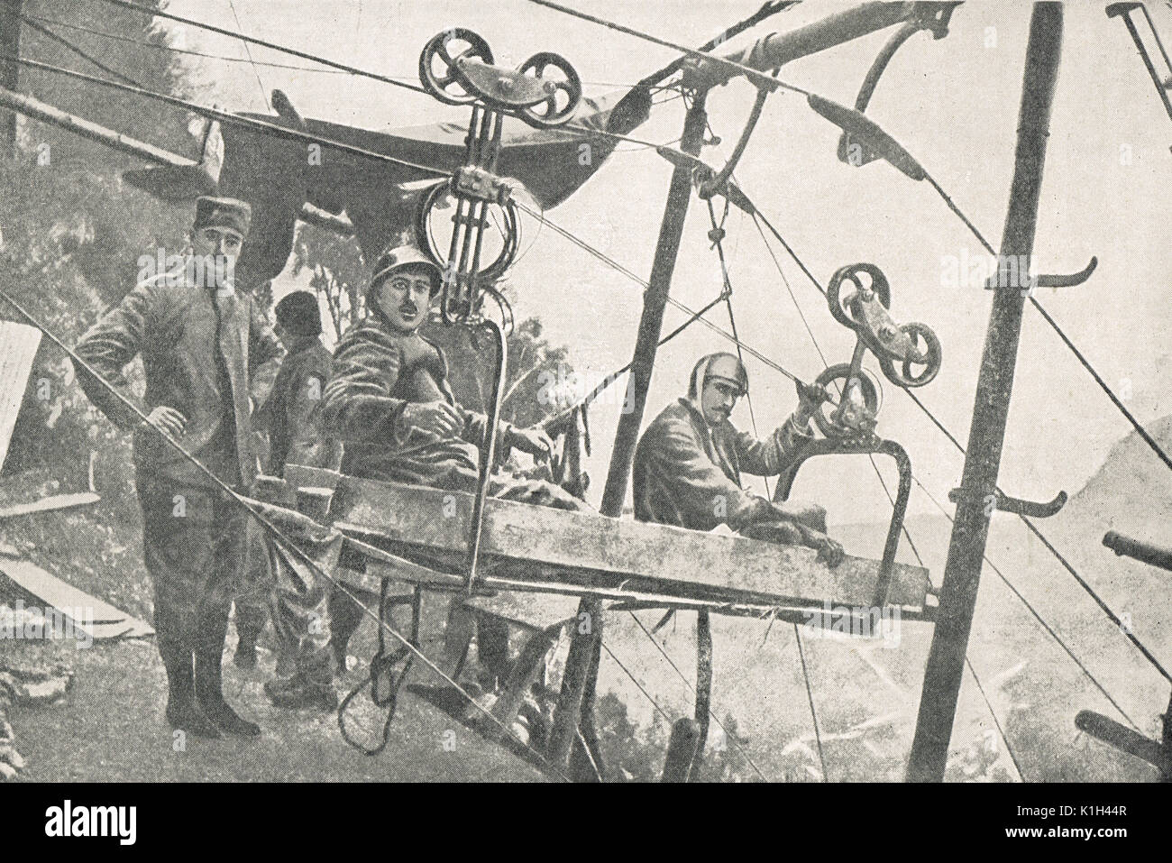 Italian soldiers wounded during fighting, Trentino, being moved by cable car, WW1 - Stock Image