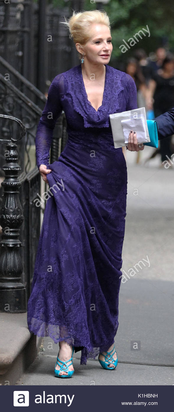 Ellen Barkin. Actress Ellen Barkin, wearing a purple evening gown ...