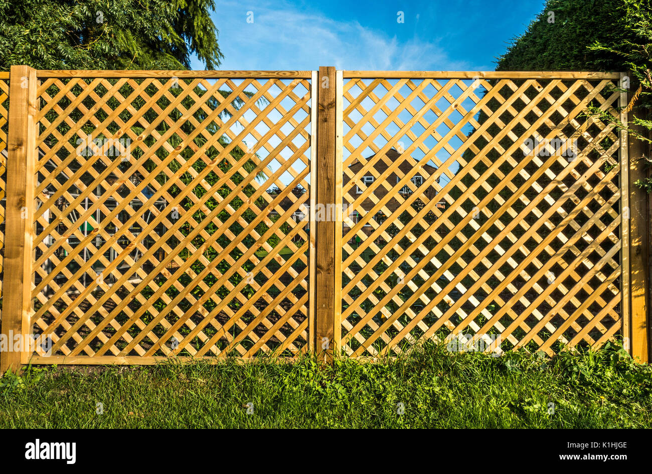 Two see through wooden trellis, boundary fence panels, with