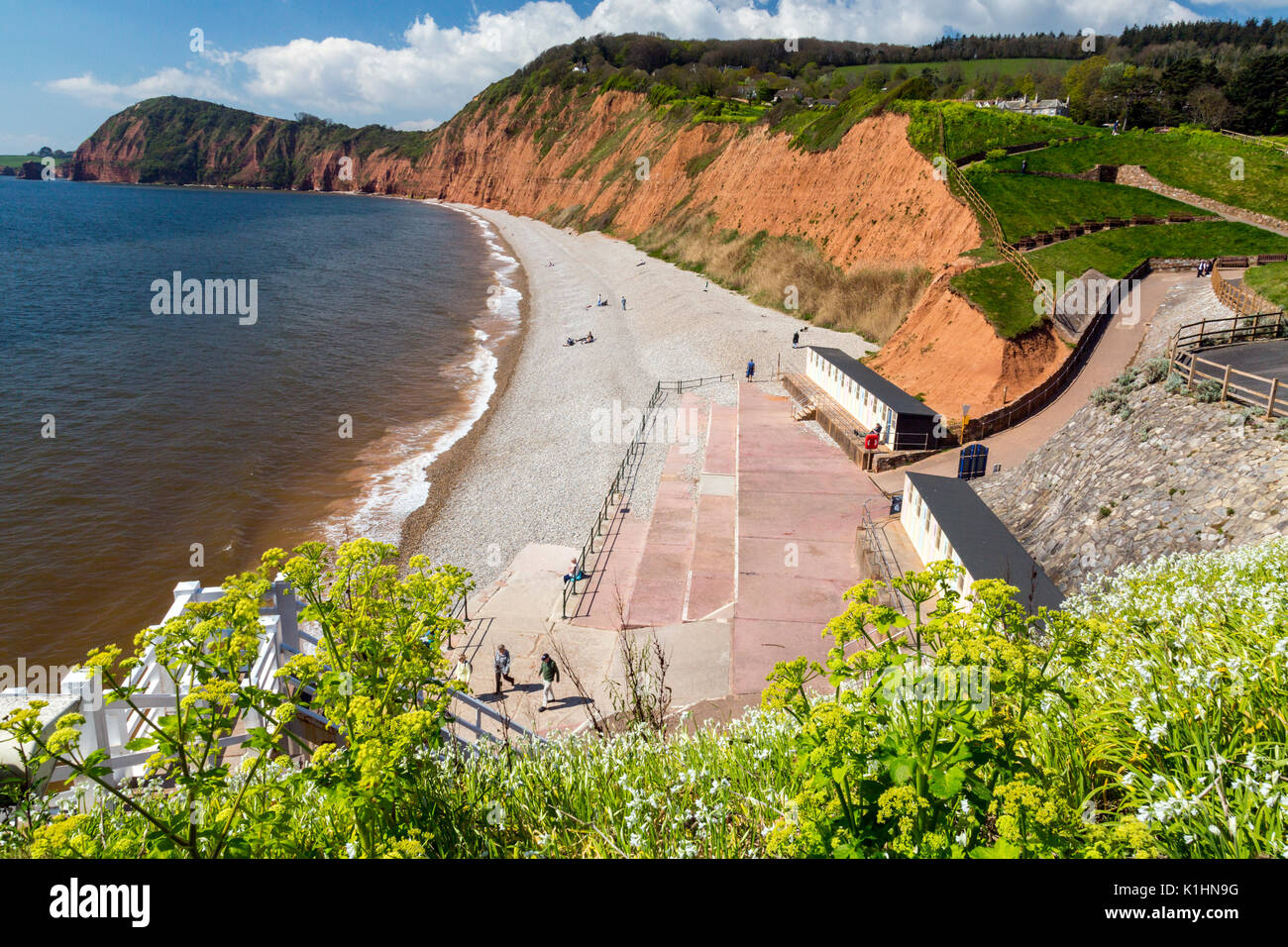 Looking west from Connaught Gardens in Sidmouth towards the towering sandstone cliffs on the Jurassic Coast, Devon, England, UK - Stock Image