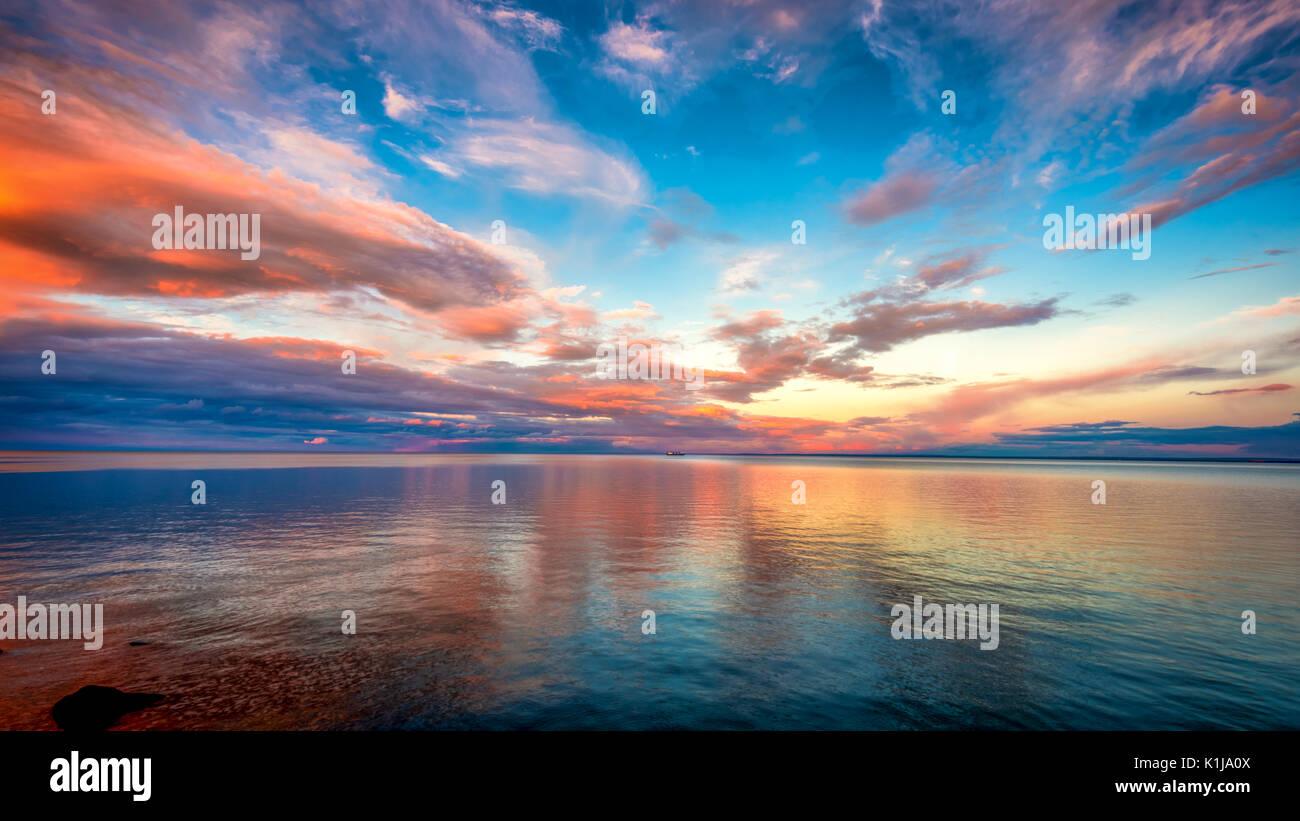 Golden orange sunset by the Lake Superior - Stock Image