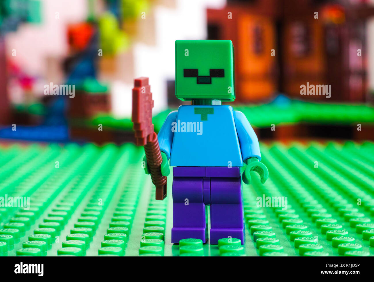 Tambov, Russian Federation - June 25, 2017 LEGO Minecraft. Zombie minifigure with shovel on green baseplate. Studio shot. - Stock Image