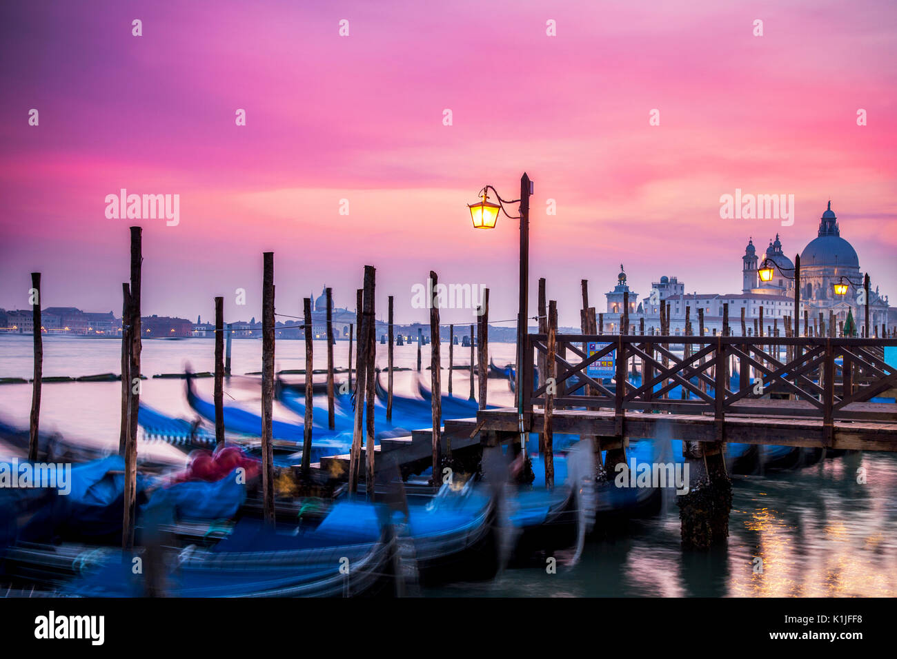 Sunset over the gondolas of Venice, Italy at St. Mark's Square. - Stock Image