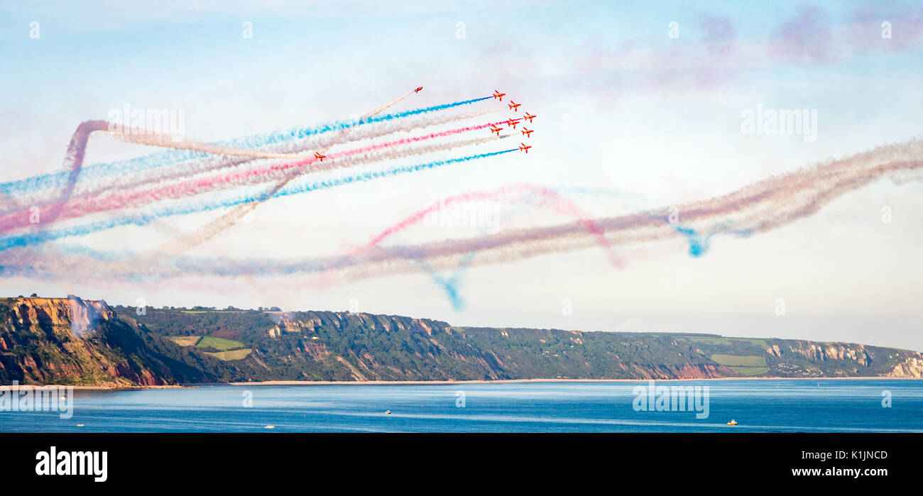 The Royal Air Force Red Arrows team perform in their BAE Hawk aircraft at their display in Sidmouth, England - Stock Image