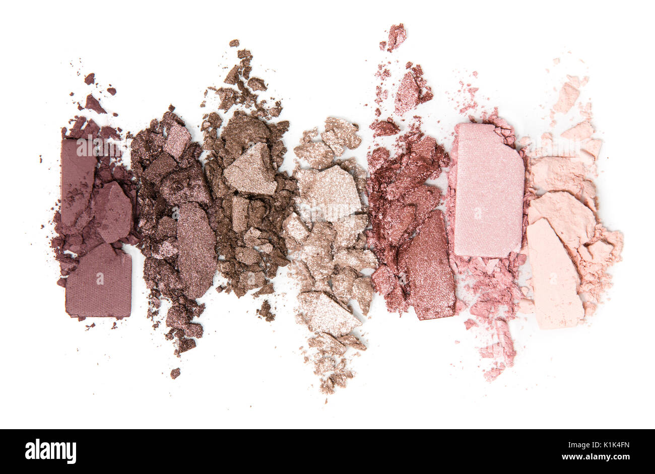 A smashed, neutral toned eyeshadow make up palette isolated on a white background - Stock Image
